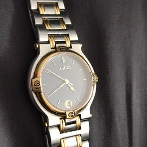 Gucci men's watch model 9000M silver and gold used